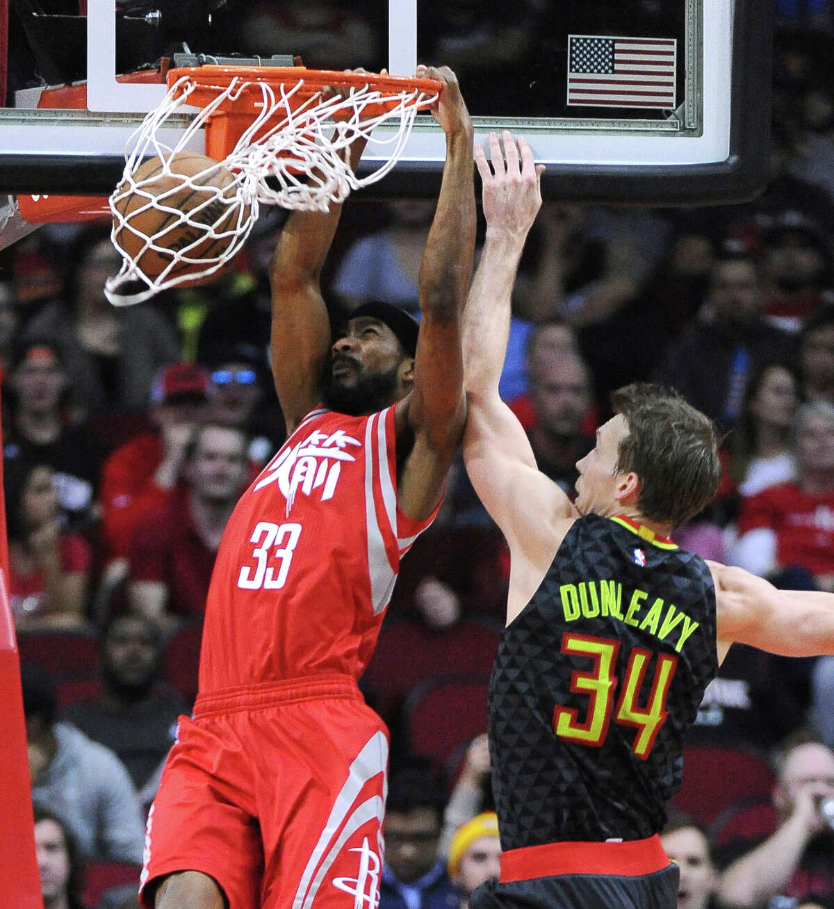 Houston Rockets guard Corey Brewer (33) dunks against Atlanta Hawks guard Mike Dunleavy (34) during the second half of an NBA basketball game Thursday, Feb. 2, 2017, in Houston. (AP Photo/George Bridges)