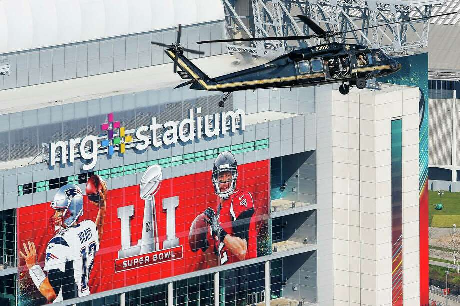 A Customs and Border Protection UH-60 Black Hawk helicopter flies over NRG Stadium before Super Bowl LI Thursday, Feb. 2, 2017 in Houston. On Sunday Customs and Border Protection will be enforcing a temporary flight restriction for aircraft within a 30 mile radius of NRG Stadium. ( Michael Ciaglo / Houston Chronicle ) Photo: Michael Ciaglo, Staff / Michael Ciaglo
