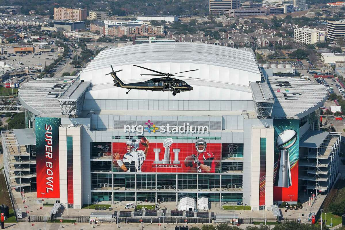 A U.S. Customs and Border Protection UH-60 Black Hawk helicopter flies over NRG Stadium on Thursday afternoon.