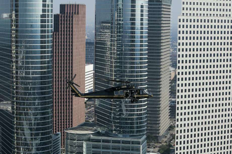 The tallest buildings in HoustonKeep going for a look at the 30 tallest towers that shape Houston's skyline. A Customs and Border Protection UH-60 Black Hawk helicopter flies over downtown Houston before Super Bowl LI Thursday, Feb. 2, 2017.  Photo: Michael Ciaglo, Staff / Michael Ciaglo