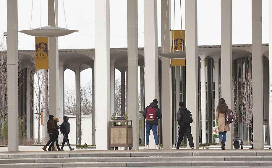 Students walk to their classes at University at Albany on Thursday Feb. 2, 2017 in Albany, N.Y. (Lori Van Buren / Times Union) , Photo: Lori Van Buren / 20039605A