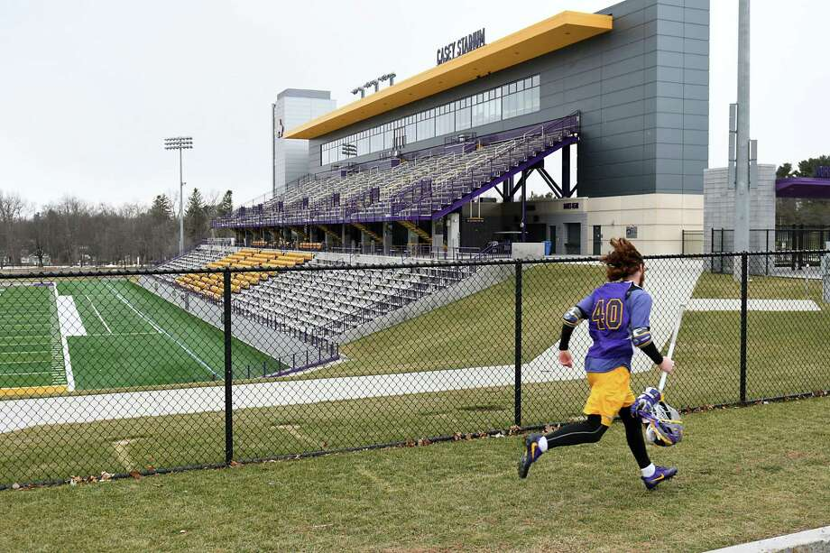 A lacrosse player runs past the football field at University at Albany on Thursday Feb. 2, 2017 in Albany, N.Y. (Lori Van Buren / Times Union) , Photo: Lori Van Buren / 20039605A