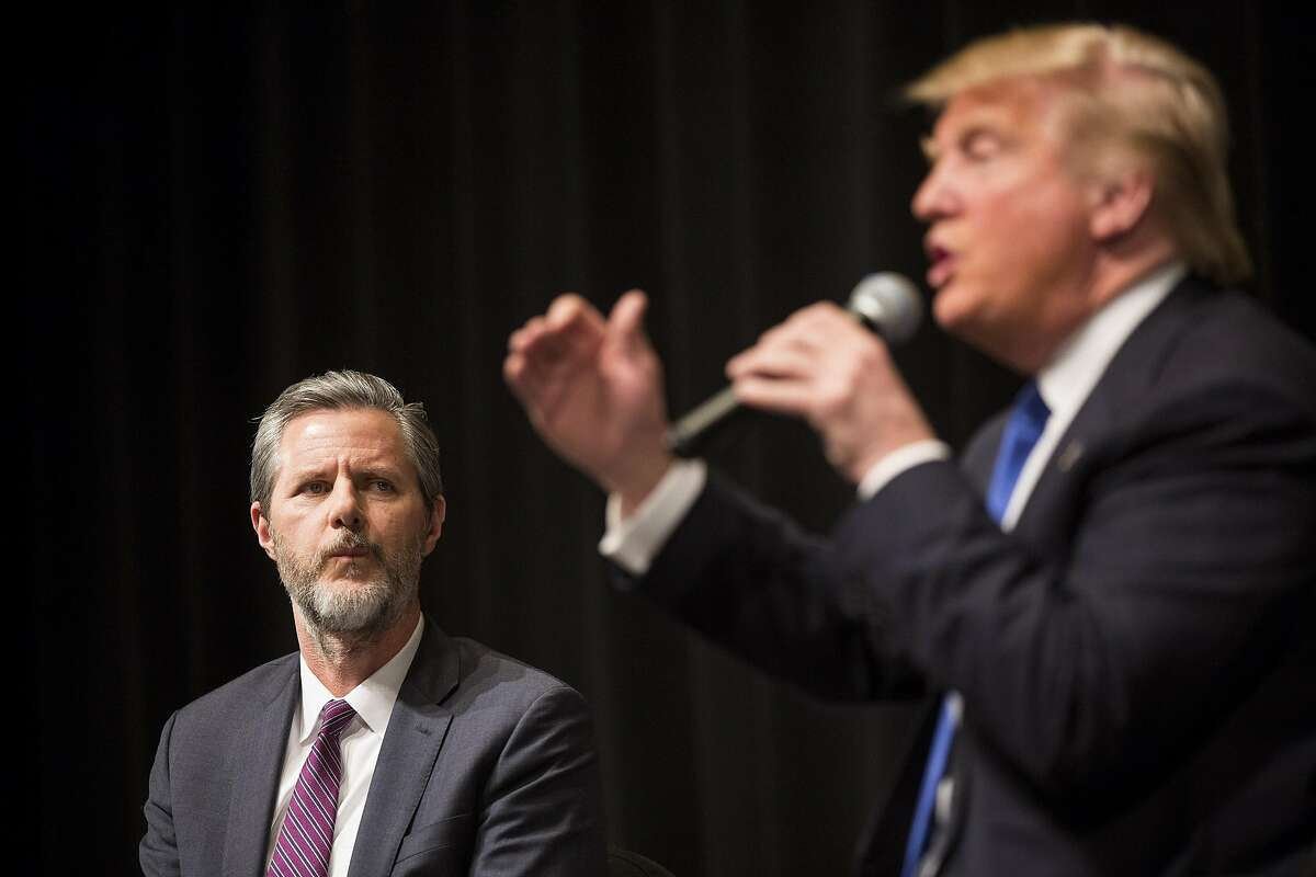 FILE � Jerry Falwell Jr. looks on as Donald Trump campaigns in Davenport, Iowa, Jan. 30, 2016. Falwell will reportedly lead a Trump administration task force charged with deregulating American higher education, one which could tremendously benefit the institution he leads: Liberty University. (Damon Winter/The New York Times)