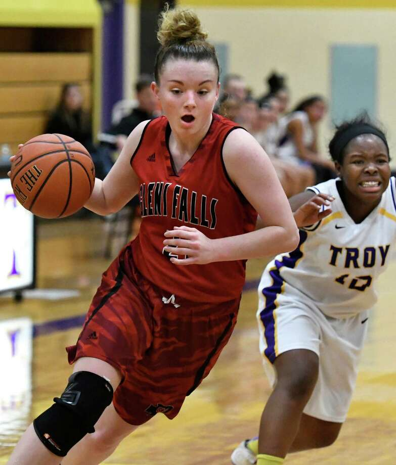 Glens Falls' Lucille Tougas, left, controls the ball as Troy's Domonique Fiddemon defends during their basketball game on Friday, Dec. 23, 2016, at Troy High in Troy, N.Y. (Cindy Schultz / Times Union) Photo: Cindy Schultz / Albany Times Union