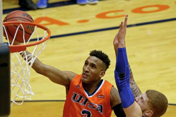 UTSA's Gino Littles shoots around Middle Tennessee's Tyrik Dixon during first half action on Feb. 2, 2017 at the Convocation Center.