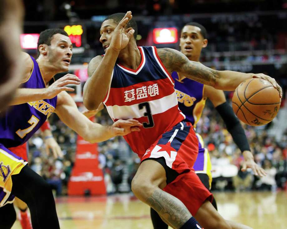 Washington Wizards guard Bradley Beal (3) drives the ball against Los Angeles Lakers forward Larry Nance Jr. (7) during the second half of an NBA basketball game in Washington, Thursday, Feb. 2, 2017. (AP Photo/Manuel Balce Ceneta) ORG XMIT: VZN112 Photo: Manuel Balce Ceneta / Copyright 2017 The Associated Press. All rights reserved.