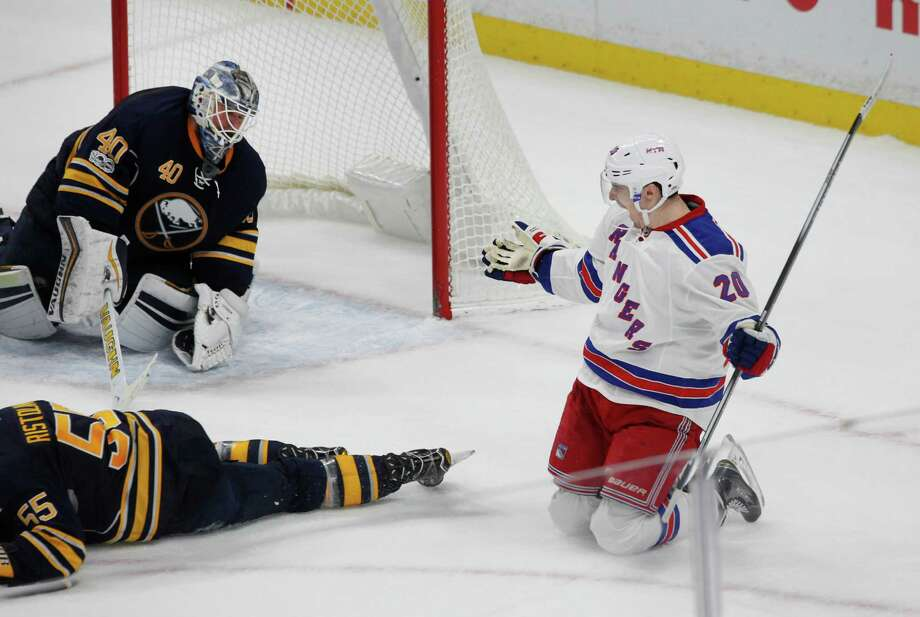 New York Rangers forward Chris Kreider (20) puts the puck past Buffalo Sabres goalie Robin Lehner (40) during the overtime period of an NHL hockey game Thursday Feb. 2, 2017, in Buffalo, N.Y. (AP Photo/Jeffrey T. Barnes) ORG XMIT: NYJB111 Photo: Jeffrey T. Barnes / 2017
