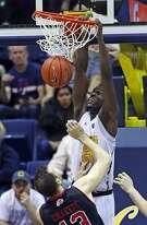 California's Jabari Bird dunks against Utah's David Collette during Cal's 77-75 double overtime win in Pac12 men's basketball game at Haas Pavilion in Berkeley, Calif., on Thursday, February 2, 2017.