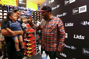 Arya Perez, 2, gives Hip Hop artist and Houston native Bun B a high-five at the Lids store in the Galleria on Thursday, Feb. 2, 2017. Arya attended the unveiling of Bub B's exclusive New Era cap collection with her father, Erick, and mother, Anna and one-year-old brother, Ezra. (Annie Mulligan / Freelance)