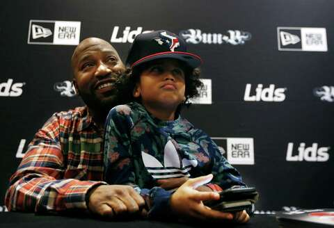 Hip Hop artist and Houston native Bun B (left) laughs with his  granddaughter ddbf47d58d4