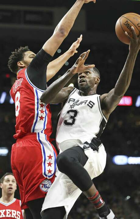 Dwayne Dedman leans up for a shot against Jahlil Okafor as the Spurs host the Sixers at the AT&T Center on February 2, 2017. Photo: Tom Reel, Staff / San Antonio Express-News / 2017 SAN ANTONIO EXPRESS-NEWS