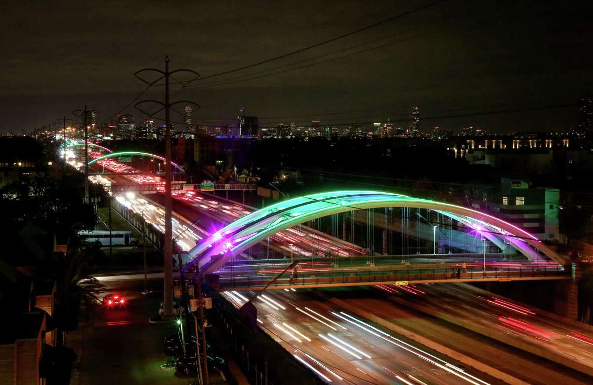 A series of bridges over Highway 59, in the Montrose area, are illuminated for the upcoming Super Bowl, Thursday, Feb. 2, 2017, in Houston.