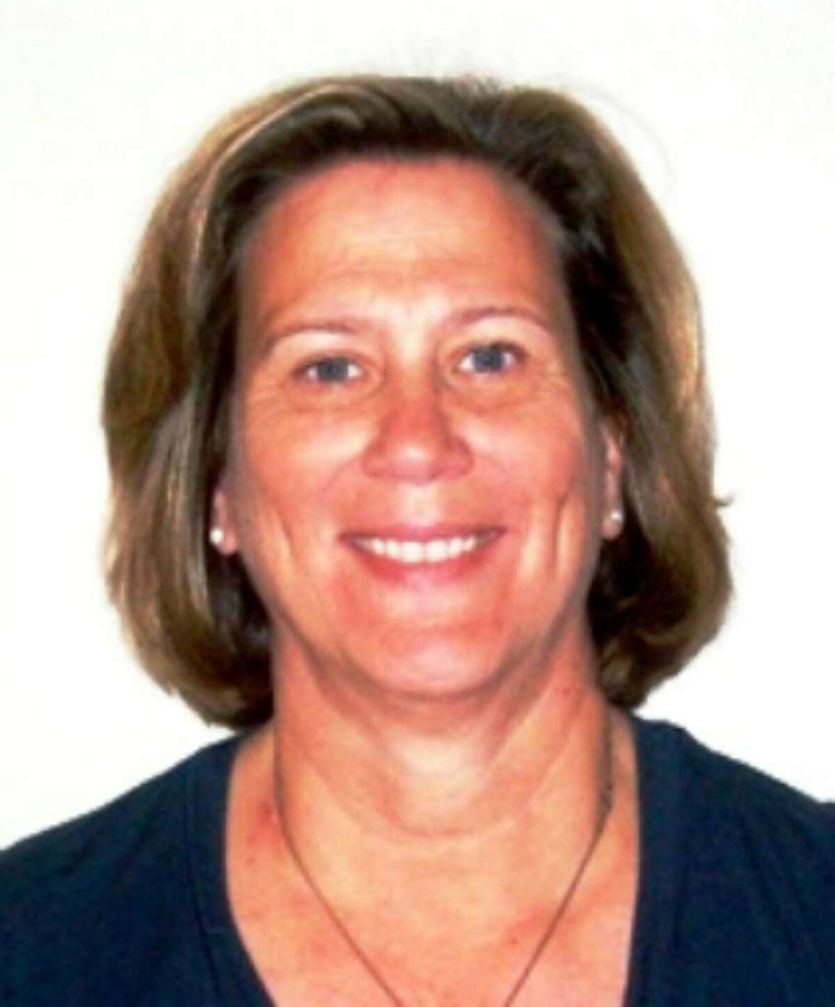Mary Schmidt. Schmidt is a 1978 UConn grad and former All-American swimmer.