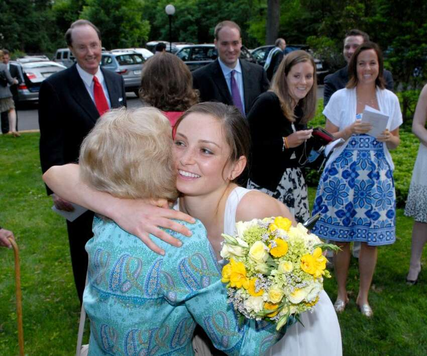 Graduating Greenwich Academy senior Sarah Canning, right, gets a hug from her grandmother Elaine Alson during the 2010 Greenwich Academy Graduation, Thursday, May 27, 2010.
