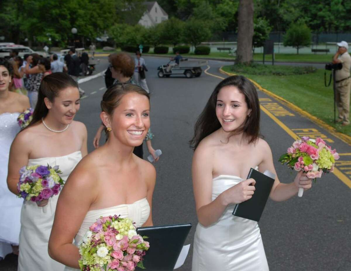 With their Greenwich Academy diplomas in hand Greenwich Academy graduating seniors, Jessica Stuart, center, and Rebekah Lowin, right, exit the 2010 Greenwich Academy Graduation, Thursday, May 27, at GA.
