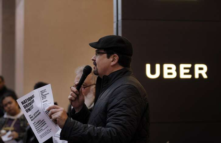 Edward Escobar with the Alliance of Independent Workers speaks to the crowd as protestors from local nonprofits, such as the East Bay Alliance for a Sustainable Economy, protested outside Uber's headquarters in San Francisco, Calif., on Thursday, February 2, 2017. The various groups wanted to remind Uber CEO Travis Kalanick that they would be vigilant of his connections with President Donald Trump after he quit Trump's  economic advisory council.