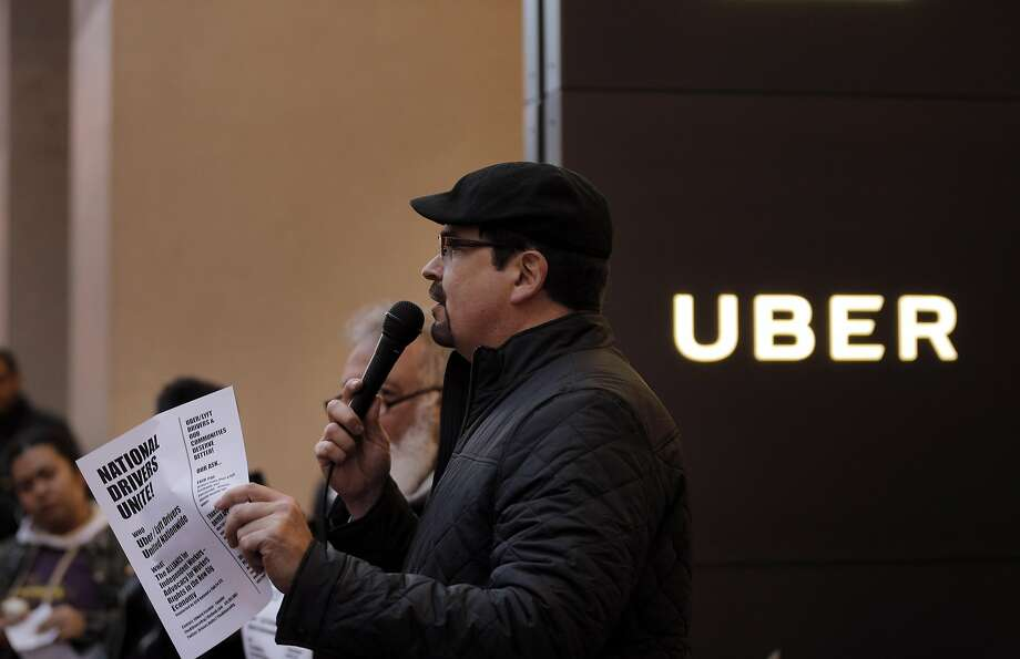 Edward Escobar of the Alliance of Independent Workers speaks during a protest at Uber, urging CEO Travis Kalanick to step down from President Trump's economic advisory council. Photo: Carlos Avila Gonzalez, The Chronicle