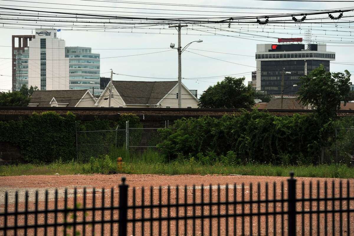 Office building in downtown Bridgeport can be seen from the property recently cleared along Barnum Ave., in Bridgeport, Conn. July 24, 2014. The property will be the location of a new commuter rail station, tentatively called Barnum Station.