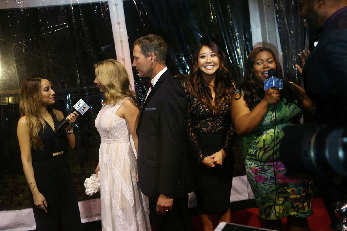 Professional poker player Maria Ho (center) smiles on the red carpet.