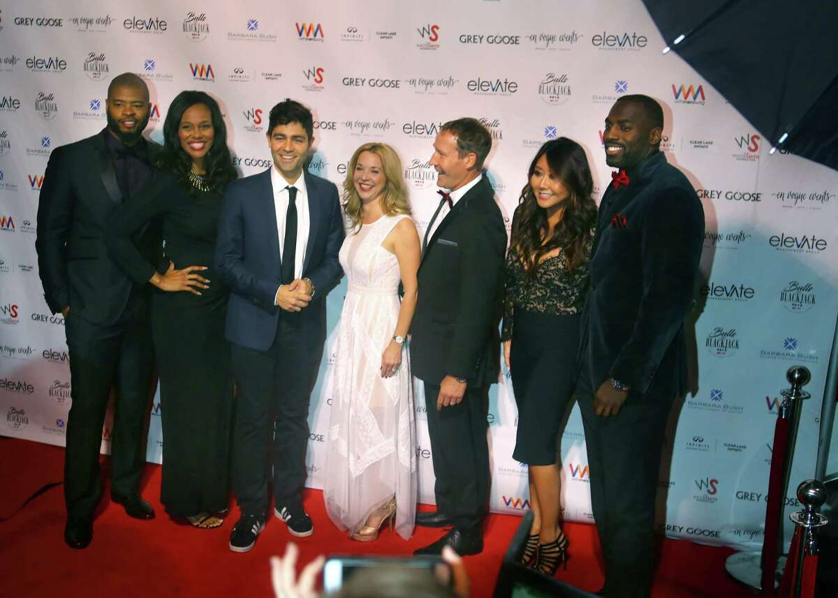 From left to right: Wade and Rita Smith, Adrian Grenier, Julie Baker Finck and Ron Finck, Maria Ho and Whitney Mercilus work the red carpet at the Bulls and Blackjack celebrity poker tournament and casino night, a fundraiser for the Barbara Bush Houston Literacy Foundation, The Wade Smith Foundation and the WithMerci Foundation, in River Oaks, Thursday, Feb. 2, 2017, in Houston.