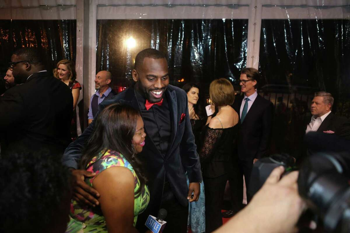 Houston Texans linebacker Whitney Mercilus works the red carpet at the Bulls and Blackjack celebrity poker tournament and casino night, a fundraiser for the Barbara Bush Houston Literacy Foundation, The Wade Smith Foundation and the WithMerci Foundation, in River Oaks, Thursday, Feb. 2, 2017, in Houston.
