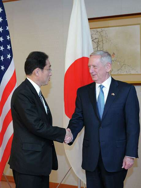 """US Defense Secretary James Mattis (R) and Japans Minister of Foreign Affairs Fumio Kishida (L) shake hands in Tokyo on February 3, 2017. Any nuclear attack by North Korea would trigger an """"effective and overwhelming"""" response, US Defence Secretary James Mattis said February 3 as he sought to reassure Asian allies rattled by President Donald Trump's isolationist rhetoric. / AFP PHOTO / POOL / DAVID MAREUILDAVID MAREUIL/AFP/Getty Images Photo: DAVID MAREUIL, Stringer / AFP/Getty Images / AFP"""