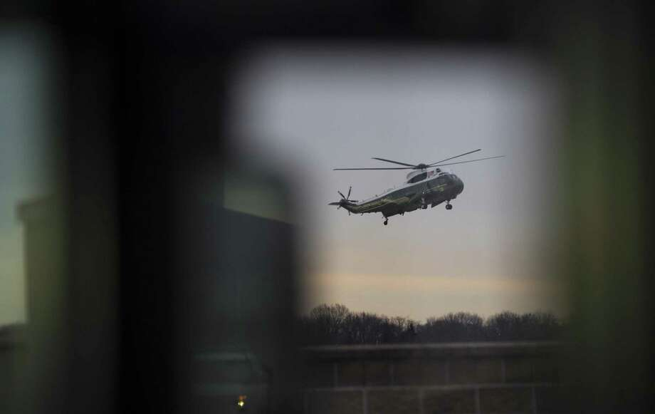 President Donald Trump arrives aboard Marine Force One to meet with the family of a Navy SEAL killed during a raid in Yemen, at Dover Air Force Base in Delaware, Feb. 1, 2017. The raid on al-Qaida militants was the first such operation ordered by Trump since he took office on Jan. 20. (Stephen Crowley/The New York Times) Photo: STEPHEN CROWLEY, STF / NYT / NYTNS