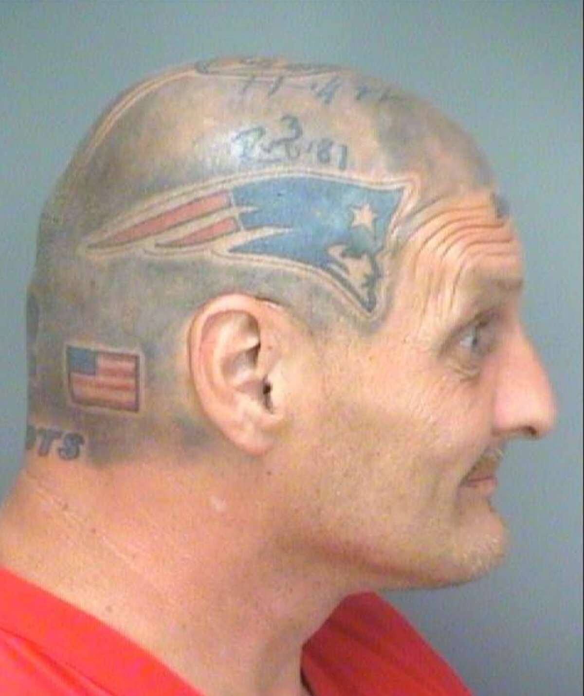 Victor Thompson, of Florida, wears his enthusiasm for the New England Patriots on his head, which is tattooed to look like a football helmet, as seen in booking photos from a September 2014 arrest in St. Petersburg. As the Patriots prepare for Super Bowl LI on Sunday, Feb. 5, 2017, in Houston, Thompson is still wanted on four drug-related warrants from Pinellas County, Fla.