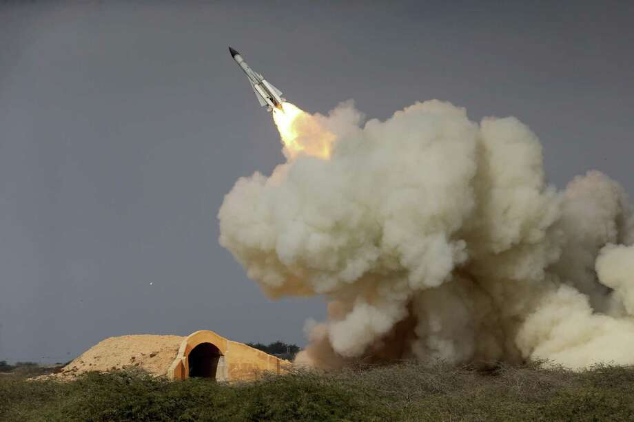 """FILE -- In this Dec. 29, 2016 file photo, released by the semi-official Iranian Students News Agency (ISNA), a long-range S-200 missile is fired in a military drill in the port city of Bushehr, on the northern coast of Persian Gulf, Iran. President Donald Trump's national security adviser, Michael Flynn, has said the U.S. is """"putting Iran on notice"""" after it test-fired a ballistic missile earlier this week. Iran has test-fired various ballistic missiles since the July 2015 nuclear deal and it's unclear, from a technological standpoint, what is different about the latest launch. (Amir Kholousi, ISNA via AP, File) Photo: Amir Kholousi, HOGP / Associated Press / ISNA"""