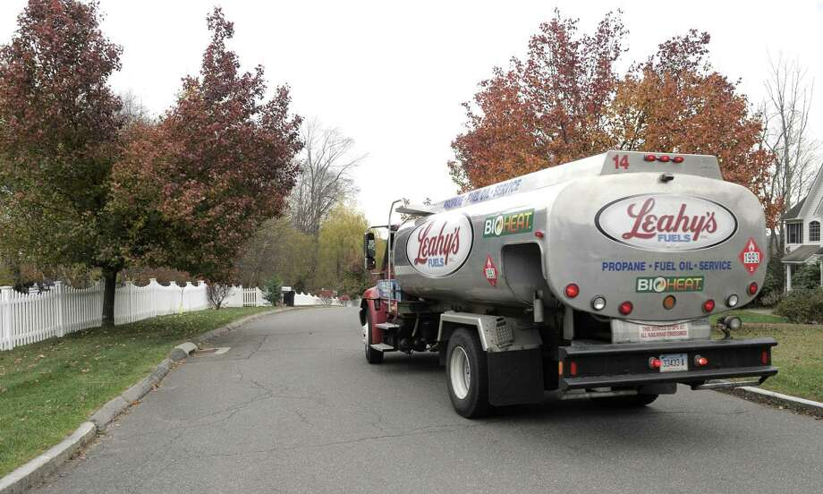 Leahy's Fuels makes a home heating oil delivery to a home in Danbury. Photo: H John Voorhees III / H John Voorhees III / The News-Times
