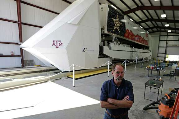 Freight Shuttle International Chairman Stephen Roop stands in front of the shuttle prototype in College Station on Sept. 1, 2016. The shuttle is an electronic shuttle system that pushes cargo containers, which could revolutionize freight transport, and is considered a potential recipient of any additional infrastructure money offered by federal officials.