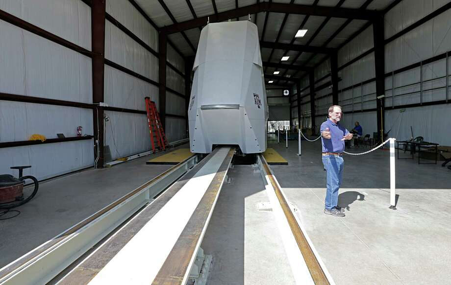 Freight Shuttle International Chairman Stephen Roop stands in front of the shuttle prototype in College Station on Sept. 1, 2016. The shuttle is an electronic shuttle system that pushes cargo containers, which could revolutionize freight transport, and is considered a potential recipient of any additional infrastructure money offered by federal officials. Photo: James Nielsen, Staff / © 2016  Houston Chronicle