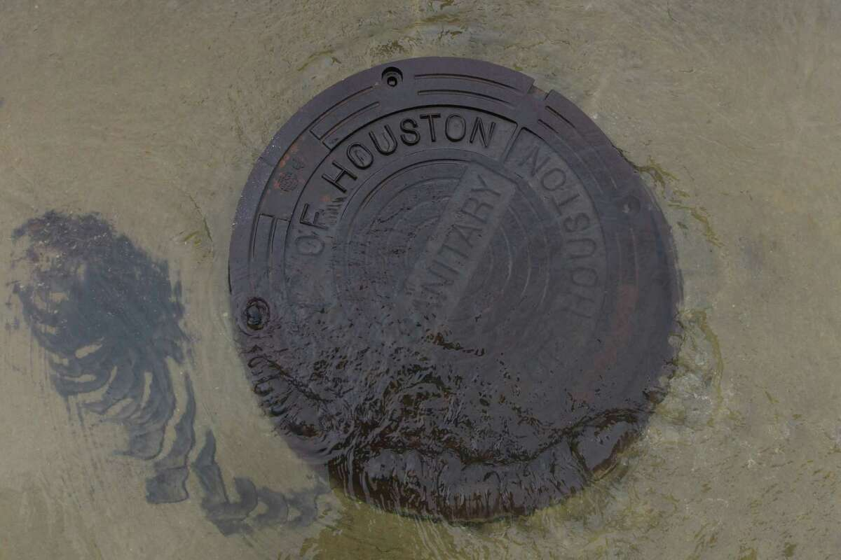 Flood water comes up from a manhole cover near Braesmont and Braeswood on Jan. 18. Fixing Houston's flood-prone areas could receive a boost from increases in infrastructure spending nationally.