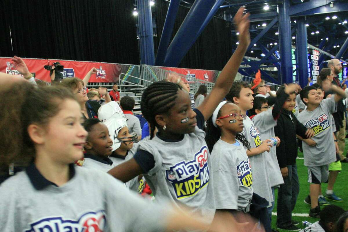 Cooper Elementary School students participate in NFL Play 60 fitness class hosted by award-winning singer and actress Jordin Sparks.