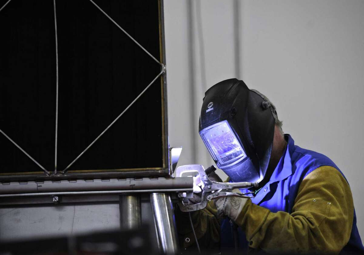 Joseph Kowalec TIG welds a heat exchange for a fuel cell at FuelCell Energy manufacturing plant in Torrington, Conn. Wednesday, February 1, 2017.