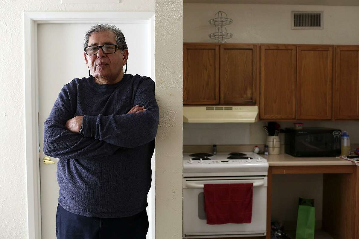 Robert Gill stands in his apartment in San Antonio on Thursday, Jan. 21, 2015. After months in a halfway house, then living in a warehouse at his brother's business, Gill had settled into his own place. He had seen his life prison sentence for drug distribution conspiracy commuted by President Obama, but on Friday, he was back before a federal judge on another drug charge.