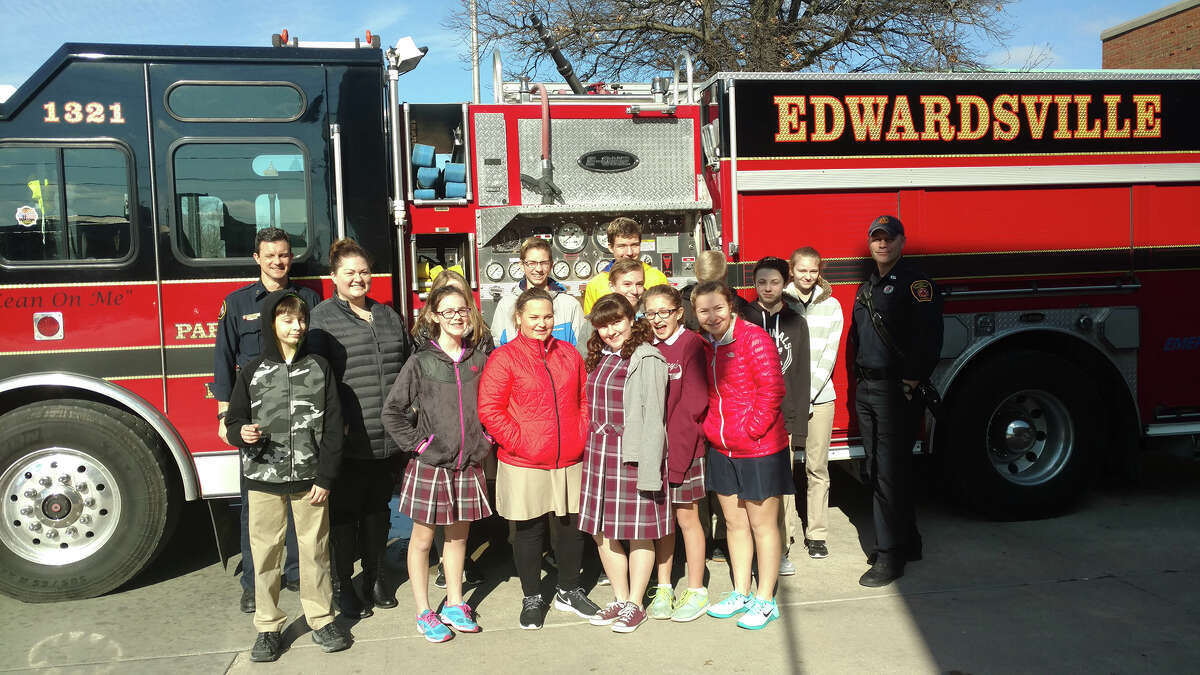 As part of Catholic Schools Week, students at St. Mary's drew pictures, wrote thank you notes and delivered cookies and treats to first responders. Students are pictured here with members of the Edwardsville Fire Department.