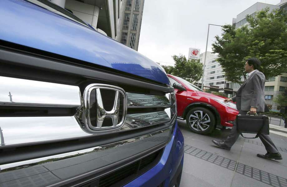 Honda says profit jumped 36 percent to $1.5 billion in the October-December quarter, shrugging off damage from a strong yen, and the Japanese automaker raised its annual forecast. Photo: Associated Press /File Photo / Copyright 2016 The Associated Press. All rights reserved. This material may not be published, broadcast, rewritten or redistribu