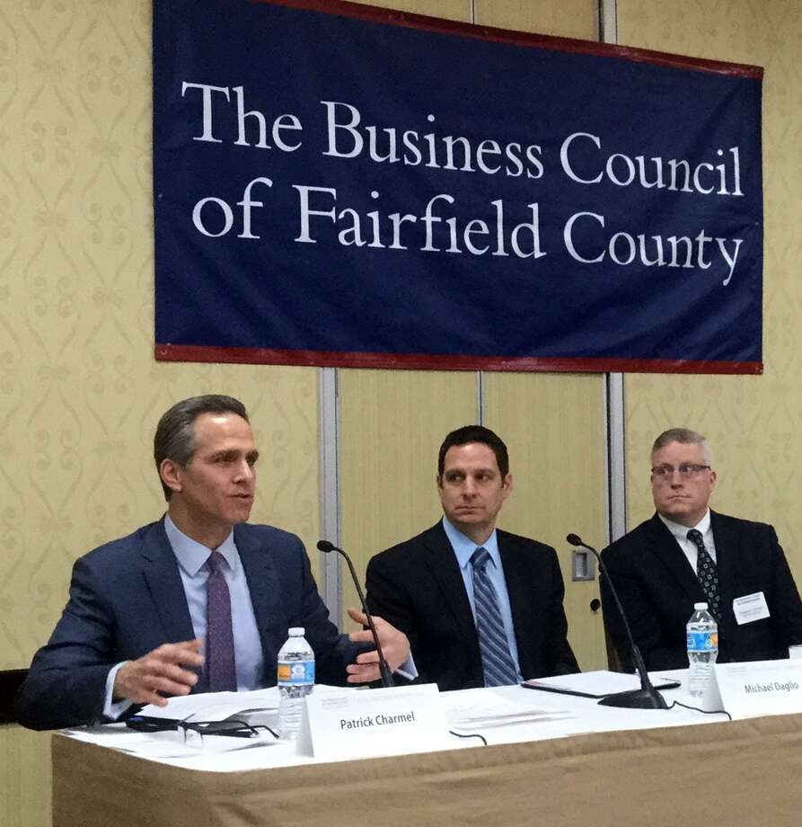 Patrick Charmel, president and CEO of Griffin Hospital, left, makes a point during a panel discussion on health care held by The Business Council of Fairfield County on Thursday, Feb. 2, 2017, at the Stamford Sheraton hotel. Photo: Paul Schott