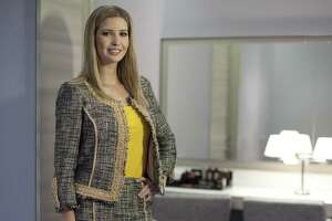 Ivanka Trump models an outfit following a 2015 interview to promote her clothing line in Toronto. In January, the first daughter's fashion line ranked No. 550 based on the number of orders from Lyst, the biggest fashion e-commerce website in the world, according to Forbes. But sales of Trump's products skyrocketed in early February, making her Lyst's 11th most popular brand.