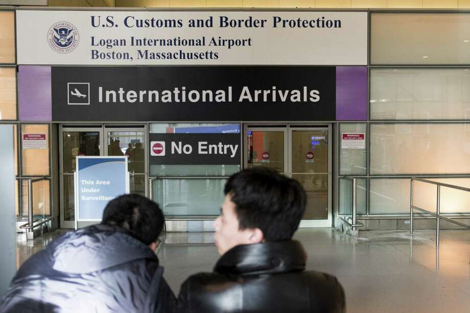 The international arrivals area of Logan Airport in Boston, Feb. 2, 2017. Much of the criticism of the executive order banning visas from certain countries signed by President Donald Trump has focused on foreigners prevented from entering the country, but a court filing in the legal battle over the travel ban reveals a far broader impact, imperiling the residency status of tens of thousands of immigrants already living in the U.S. (M. Scott Brauer/The New York Times) Photo: M. SCOTT BRAUER, STR / NYT / NYTNS