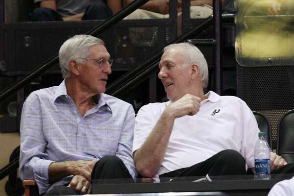 San Antonio Spurs Head Coach Gregg Popovich, right, talks with former Utah Jazz Head Coach Jerry Sloan during an intrsquad scrimmage at the AT&T Center, Wednesday, Oct. 3, 2012.