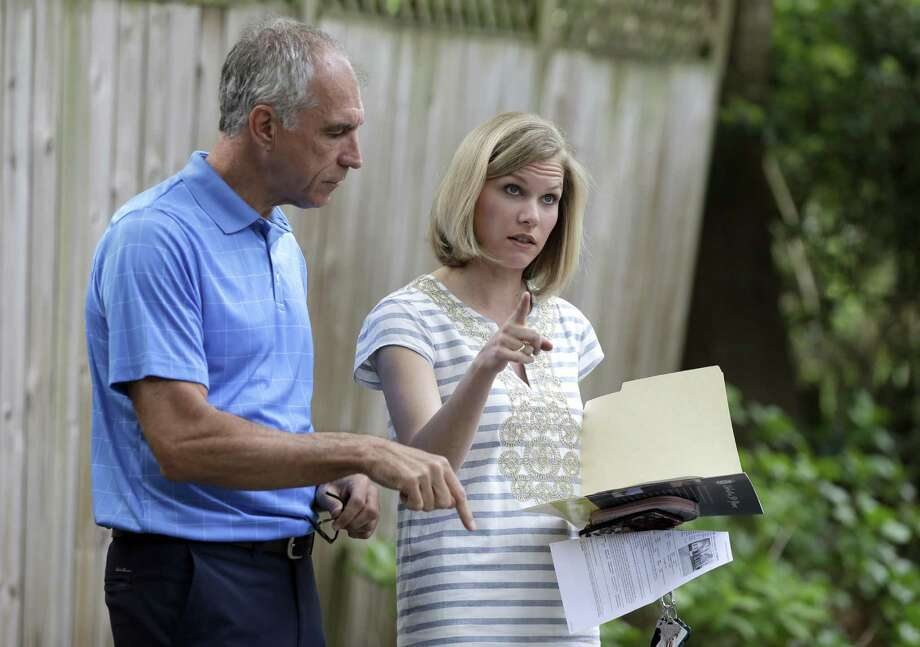 A real estate agent goes over a home listing with a client. The Institute for Supply Management, says its services index declined to 56.5 in January from 56.6 in December. Nevertheless, the services sector has now expanded for 85 straight months. Photo: Associated Press /File Photo / Copyright 2016 The Associated Press. All rights reserved. This material may not be published, broadcast, rewritten or redistribu