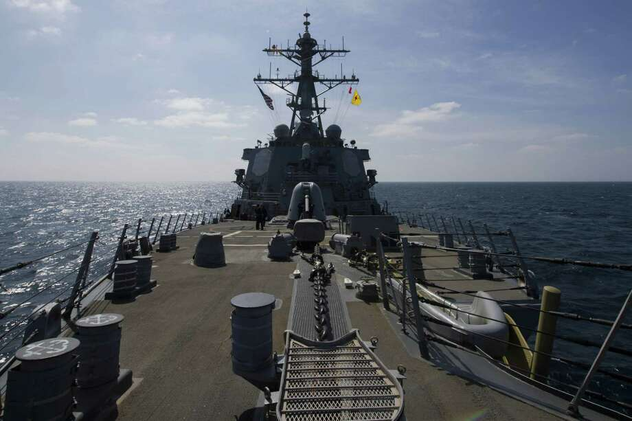 This US Navy photo obtained February 3, 2017 shows the Arleigh Burke-class guided-missile destroyer USS Cole (DDG 67) as it flies the National Ensign and the 4th Marine Division (MARDIV) flag on January 16, 2017 during the Cole Memorial wreath-laying ceremony that honored the 17 Sailors who lost their lives on October 12, 2000.  Cole is deployed in the US 5th Fleet area of operations in support of maritime security operations and theater security cooperation efforts. The US Navy has sent a destroyer to waters off Yemen in response to an attack by Iran-backed Houthi rebels on a Saudi frigate, a defense official said ON fEBRUARY 3, 2017. The USS Cole, which had been conducting operations in the Gulf, is now stationed in the Bab al-Mandab Strait off southwestern Yemen, the official said.  / AFP PHOTO / Navy Office of Information / Handout / RESTRICTED TO EDITORIAL USE - MANDATORY CREDIT AFP PHOTO /US NAVY/MC3 BRIANNA K. GREEN  - NO MARKETING - NO ADVERTISING CAMPAIGNS - DISTRIBUTED AS A SERVICE TO CLIENTS  HANDOUT/AFP/Getty Images Photo: HANDOUT, Stringer / AFP/Getty Images / AFP