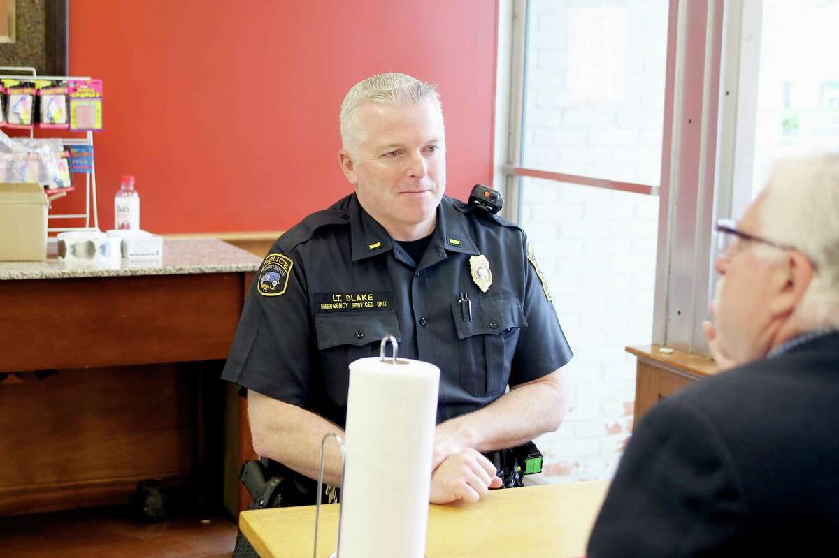 """Lt. Terry Blake speaks to a citizen during the inaugural Norwalk Police Department's """"Coffee with a Cop"""" opportunity to join police officers for coffee and conversation in this file photo. Blake is featured prominently in a newly released video by the U.S. Attorney's Office features about community outreach initiatives in Norwalk."""