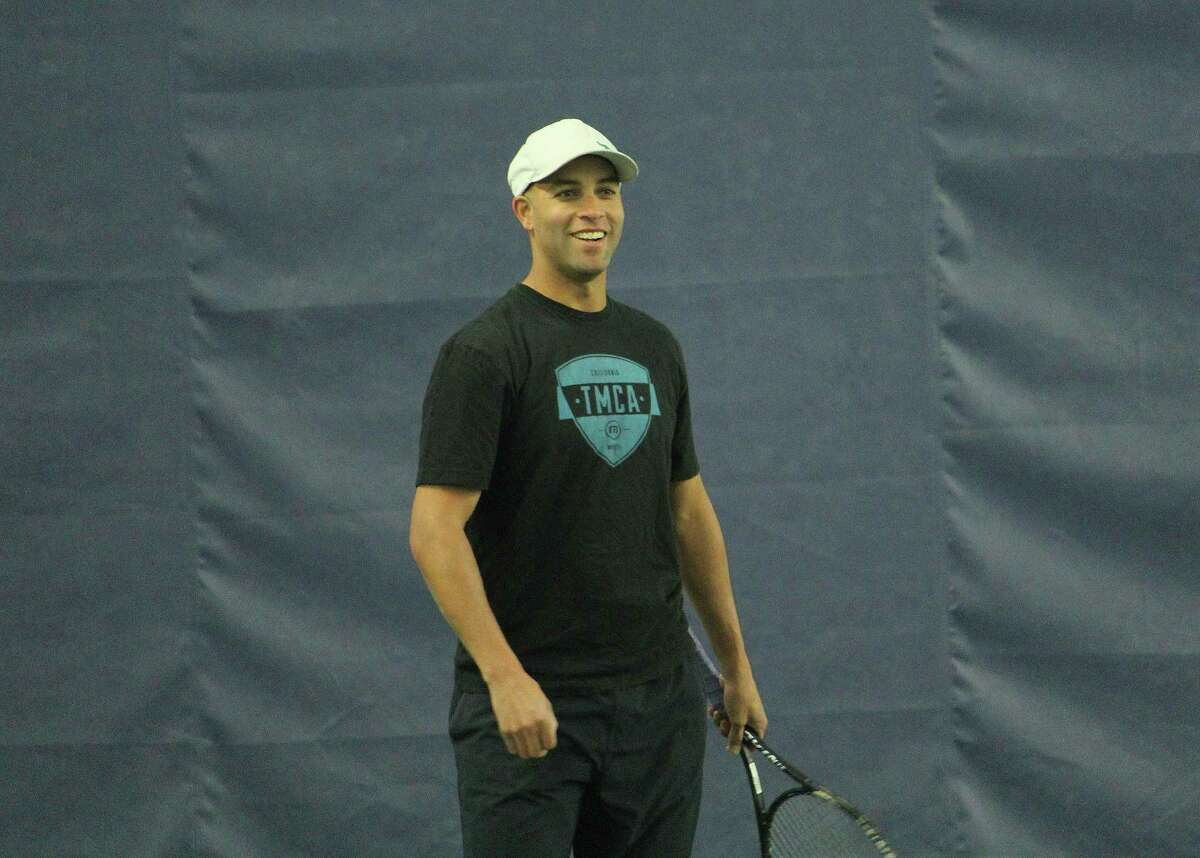 James Blake played with Fairfield University staff, alumni and tennis players and ran a youth clinic with high school seniors from Bridgeport's Hall Neighborhood House at the Tennis Club of Trumbull on Monday.