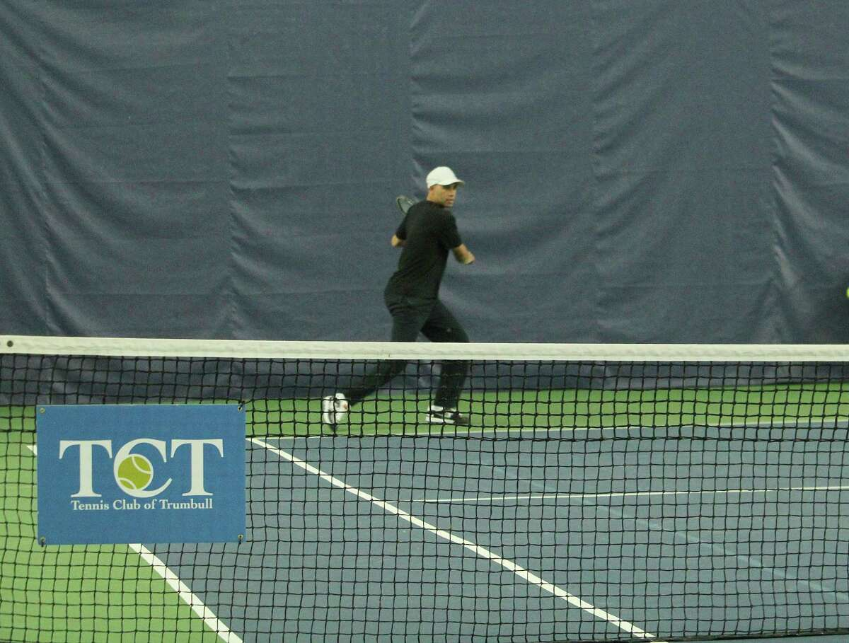 James Blake played with Fairfield University staff, alumni and tennis players and ran a youth clinic with high school seniors from Bridgeport's Hall Neighborhood House at the Tennis Club of Trumbull in Trumbull, Conn. Jan. 30, 2017.