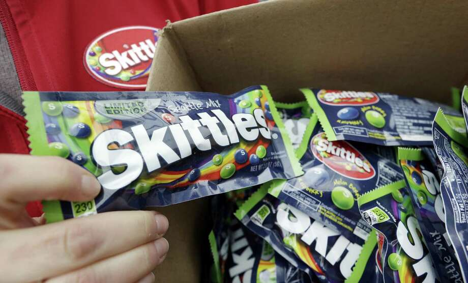 Mars says it was a miscommunication with a subcontractor that led to a defective batch of its Skittles being spilled on a highway while they were reportedly on their way to becoming cattle feed. Photo: Associated Press /File Photo / Copyright 2017 The Associated Press. All rights reserved.