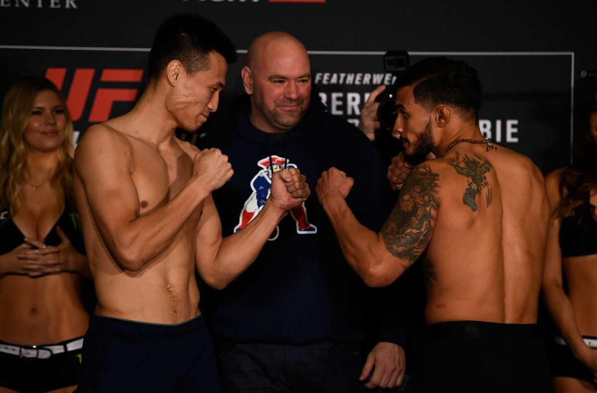 HOUSTON, TEXAS - FEBRUARY 03: (L-R) Opponents Chan Sung Jung of South Korea and Dennis Bermudez face off during the UFC Fight Night weigh-in at the Sheraton North Houston at George Bush Intercontinental on February 3, 2017 in Houston, Texas. (Photo by Jeff Bottari/Zuffa LLC/Zuffa LLC via Getty Images)