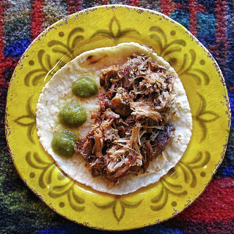 Carnitas taco on a handmade corn tortilla from El San Luis. Photo: Mike Sutter /San Antonio Express-News